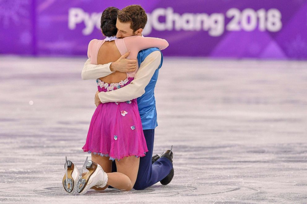 South Korea's Alexander Gamelin and Yura Min hold each other after they finished their routine in the ice dance free dance of the figure skating event, Feb. 20, 2018.