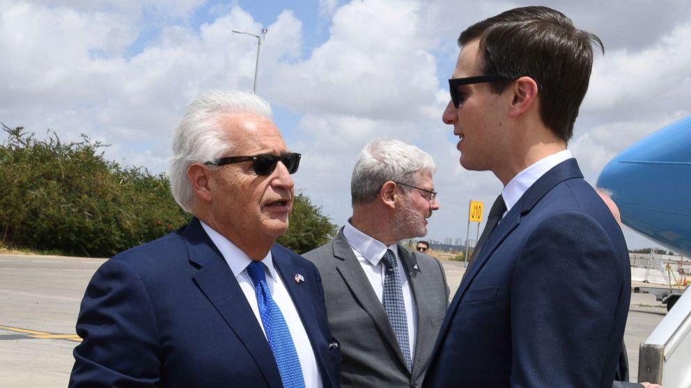 A handout photo made available by the US embassy in Tel Aviv shows US Ambassador to Israel David Friedman, left welcoming Jared Kushner upon arrival near Lod, Israel, May 13, 2018.