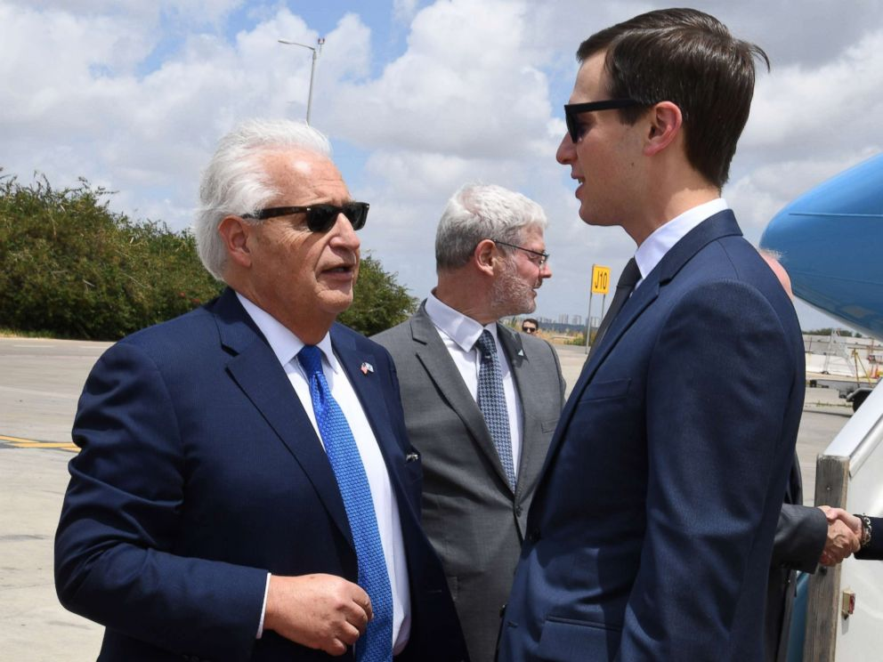 PHOTO: A handout photo made available by the US embassy in Tel Aviv shows US Ambassador to Israel David Friedman, left welcoming Jared Kushner upon arrival near Lod, Israel, May 13, 2018.
