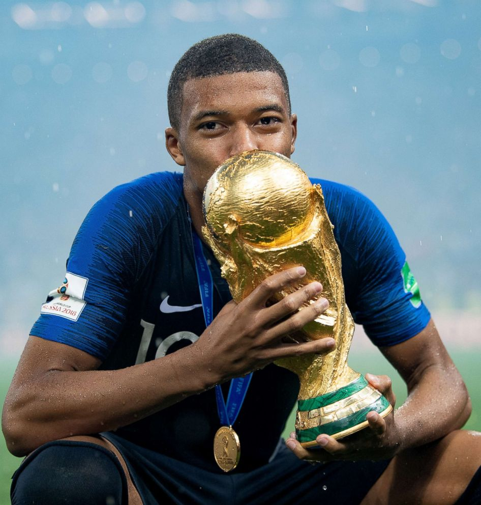 PHOTO: Kylian Mbappe of France celebrates with the World Cup Trophy after winning the 2018 FIFA World Cup final against Croatia at Luzhniki Stadium, July 15, 2018, in Moscow, Russia.
