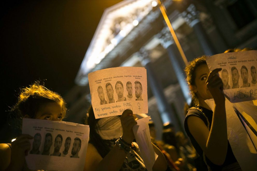 PHOTO: Women, some holding photographs of the five men known as La Manada or The Pack and reading: Rapists and We dont want your photos but your heads, march outside the Spanish parliament during a protest in Madrid, April 26, 2018.