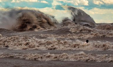 PHOTO: Dave Sandford photographing waves in Lake Erie.