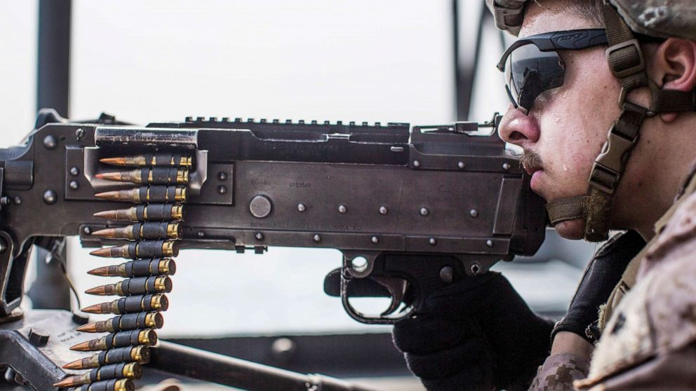 PHOTO: U.S. Marine Corps Lance Cpl. Adrian Hannabradley provides security with an M240B machine gun during a strait transit aboard the amphibious assault ship USS Boxer, July 18, 2019.