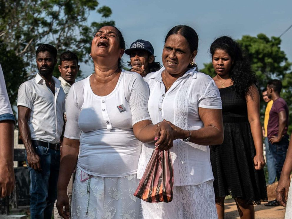 PHOTO: A crying woman is comforted as she leaves a funeral for a person killed in the Easter Sunday attack on St Sebastians Church, April 23, 2019, in Negombo, Sri Lanka.