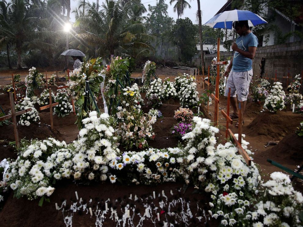 PHOTO: People come to the site of a mass burial to pay their respects to victims of a string of suicide bomb attacks on churches and luxury hotels on Easter Sunday, in Negombo, Sri Lanka, April 25, 2019.