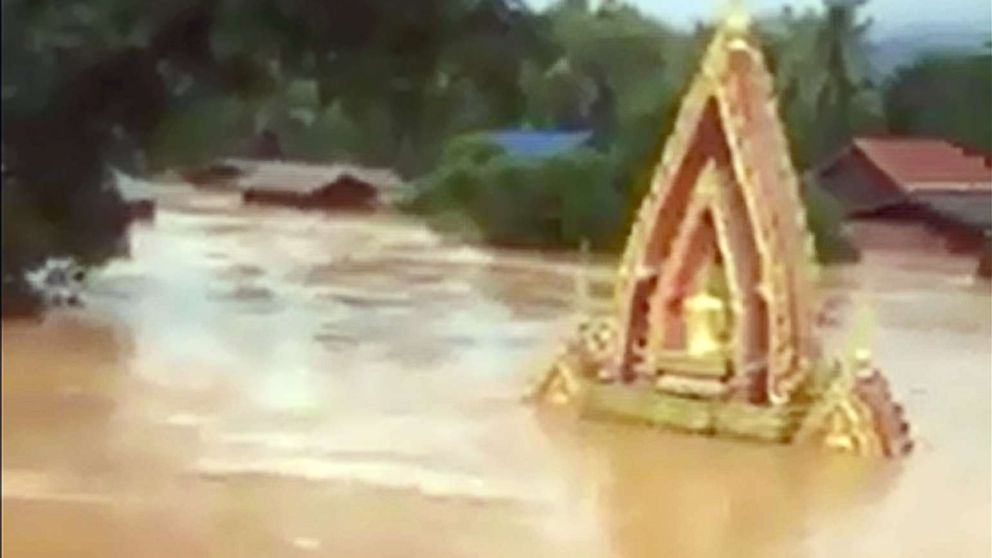 This screen grab taken on handout video footage from ABC Laos on July 24, 2018 shows various structures surrounded by floodwaters in Attapeu province after a dam collapsed the day before.