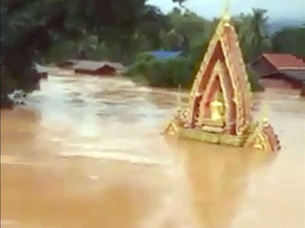 PHOTO: This screen grab taken on handout video footage from ABC Laos on July 24, 2018 shows various structures surrounded by floodwaters in Attapeu province after a dam collapsed the day before.