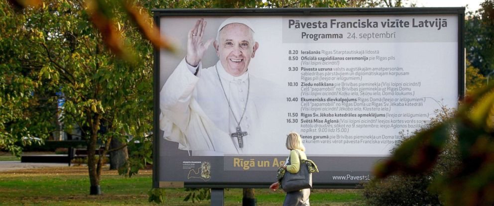 PHOTO: A woman walks next to a billboard advert of Pope Francis upcoming visit to Latvia, in Riga, Latvia, Sept. 20, 2018.