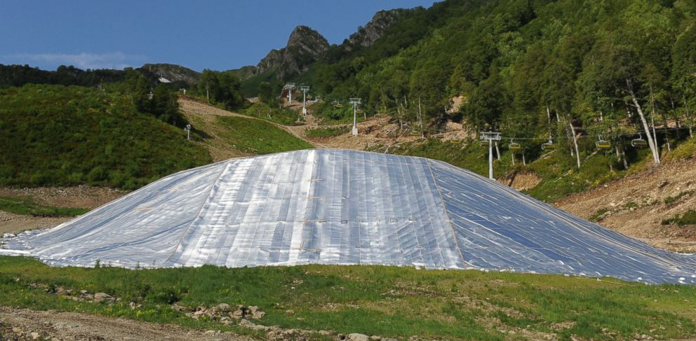 PHOTO: Insulated blankets cover a pile of snow at the Rosa Khutor alpine ski resort outside Krasnaya Polyana, Russia, June 26, 2013.