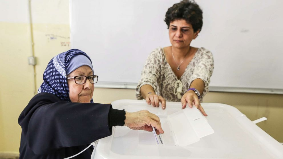A Lebanese woman casts her vote at a ballot station in Baabda, south east Beirut, Lebanon, May 06, 2018.