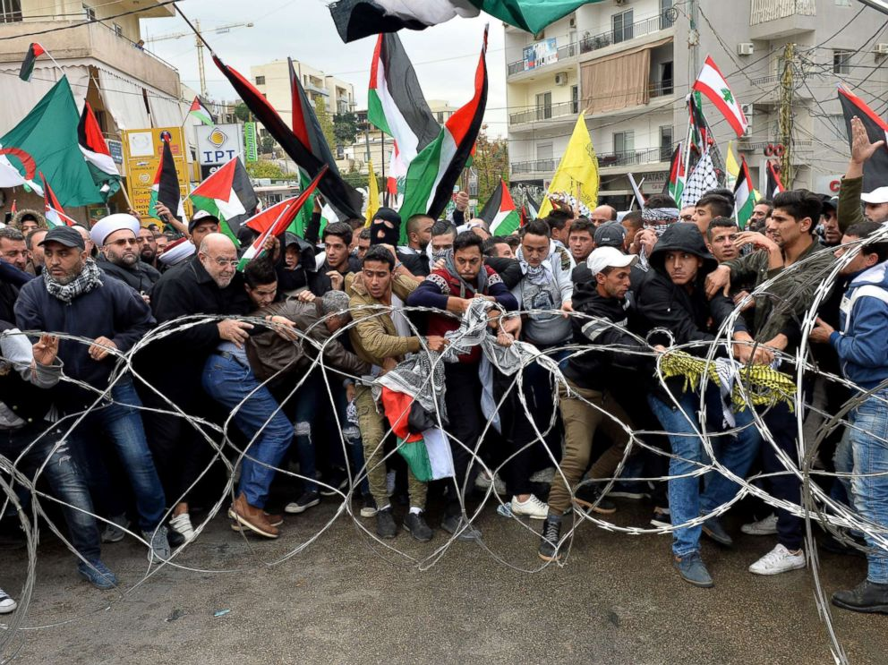 PHOTO: Protesters try to remove barbed wires that block a road near the U.S. embassy during a protest against President Donald Trumps decision to recognize Jerusalem as the Capital of Israel, in Awkar, east of Beirut, Lebanon, Dec. 10, 2017.