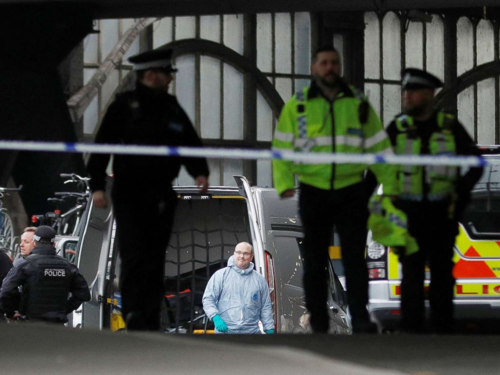 PHOTO: Police officers including one wearing a forensic suit, are seen in a cordoned off area at Waterloo station near to where a suspicious package was found, in London, March 5, 2019.