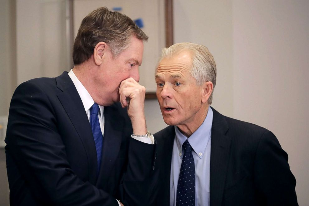 PHOTO: Trade Representative Robert Lighthizer, left, and White House National Trade Council Director Peter Navarro talk, March 8, 2018, at the White House in Washington.
