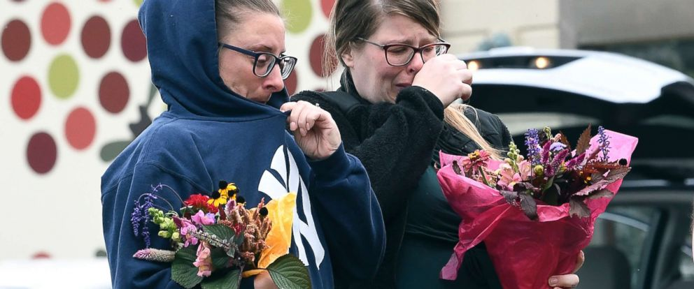 PHOTO: People place flowers, Oct. 7, 2018, at the scene where 20 people died as the result of a limousine crashed at an intersection a day earlier, in Schoharie, N.Y.