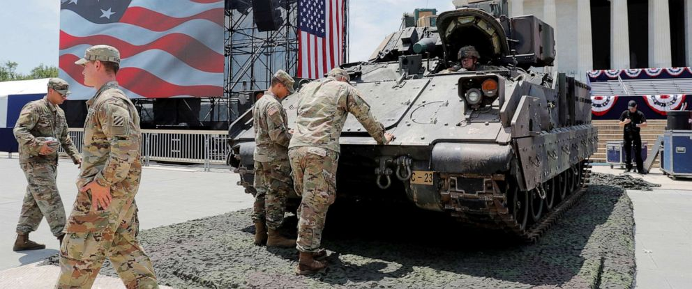 PHOTO: Members of the U.S. Armys 3rd Infantry Division, 1st Battalion, 64th Armored Regiment based at Fort Stewart, Ga., assist as a Bradley Fighting Vehicle is moved into place ahead of a July Fourth celebration in Washington, July 3, 2019.