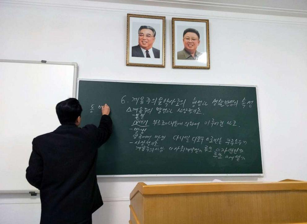 PHOTO: A literary teacher writes on a blackboard in a classroom at Kim Il Sung University, Pyongyang, North Korea