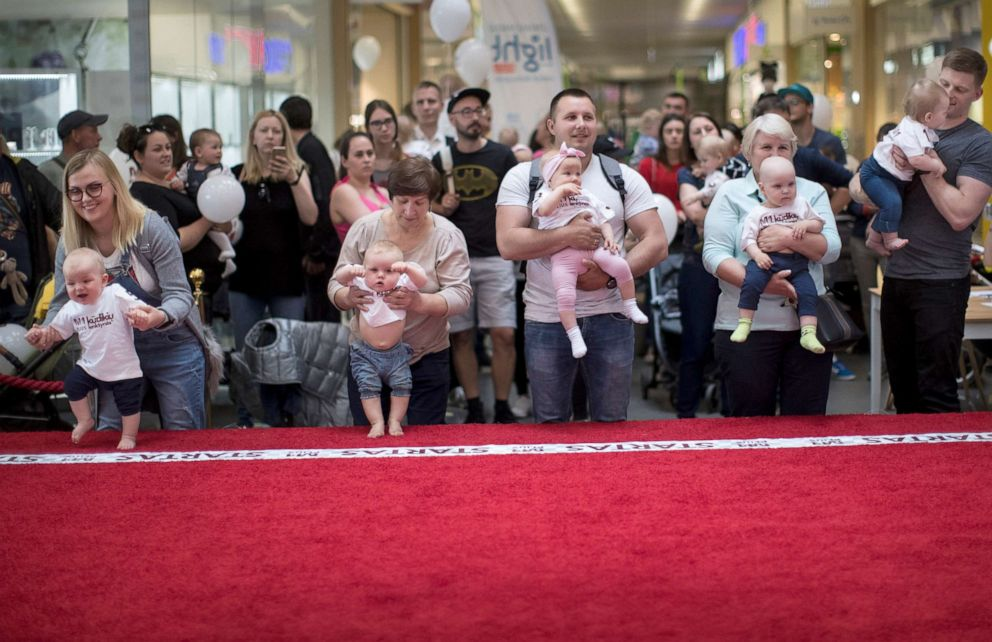 PHOTO: Parents prepare to release their babies during the Baby Race event to mark international Childrens Day in Vilnius, Lithuania, June 1, 2019.