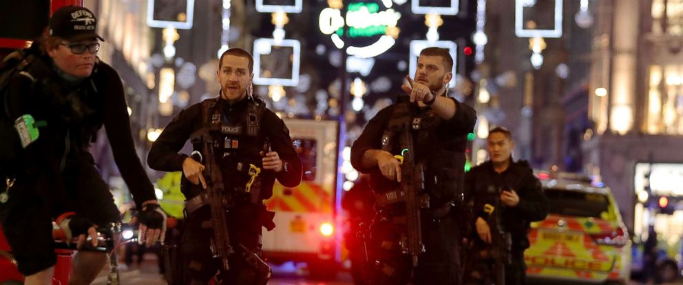 PHOTO: Armed police gesture as they walk along Oxford street following an incident in central London on Nov. 24, 2017.