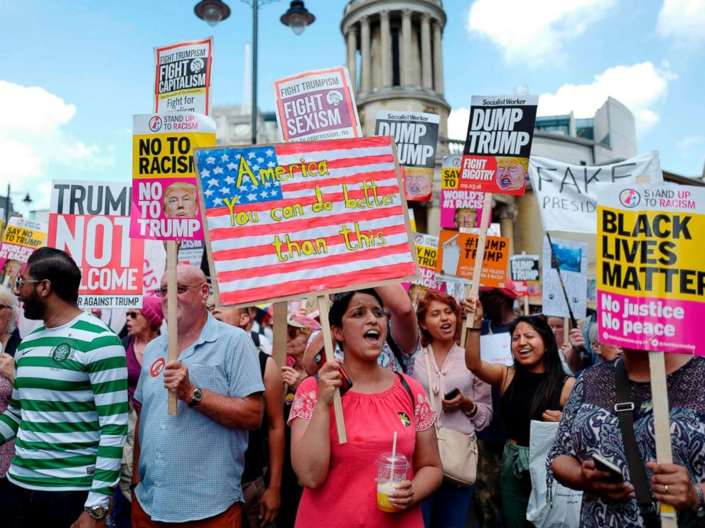 PHOTO: Protesters gather with placards to take part in a march and rally against President Donald Trumps visit to Britain, on July 13, 2018 in London.