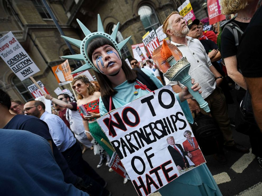 PHOTO: A protester takes part in a demonstration against President Trumps visit to the U.K., near Portland Place on July 13, 2018 in London.
