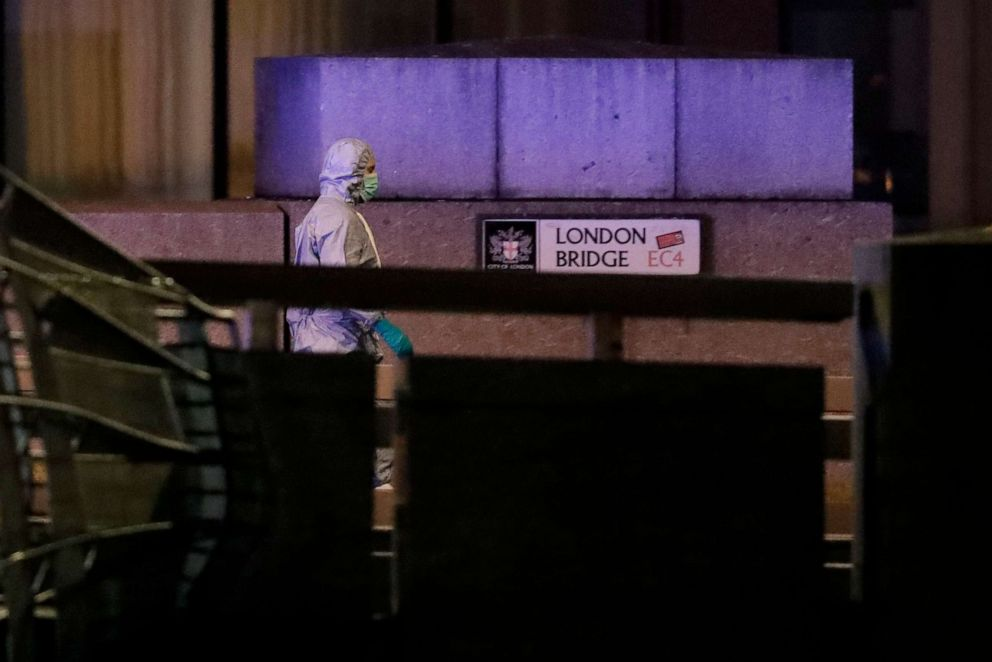 PHOTO: A police forensic officer walks by a sign on London Bridge following an incident in London, Nov. 29, 2019.