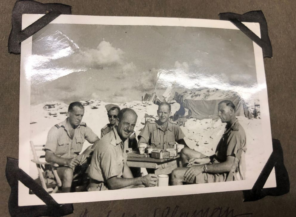 PHOTO: Harold Claridge surrounded by other officers in the desert at Alamein, Egypt.