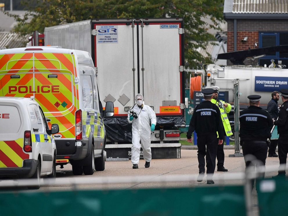 PHOTO: British Police officers in forsensic suits work near a lorry, found to be containing 39 dead bodies, inside a police cordon at Waterglade Industrial Park in Grays, east of London, on Oct. 23, 2019.