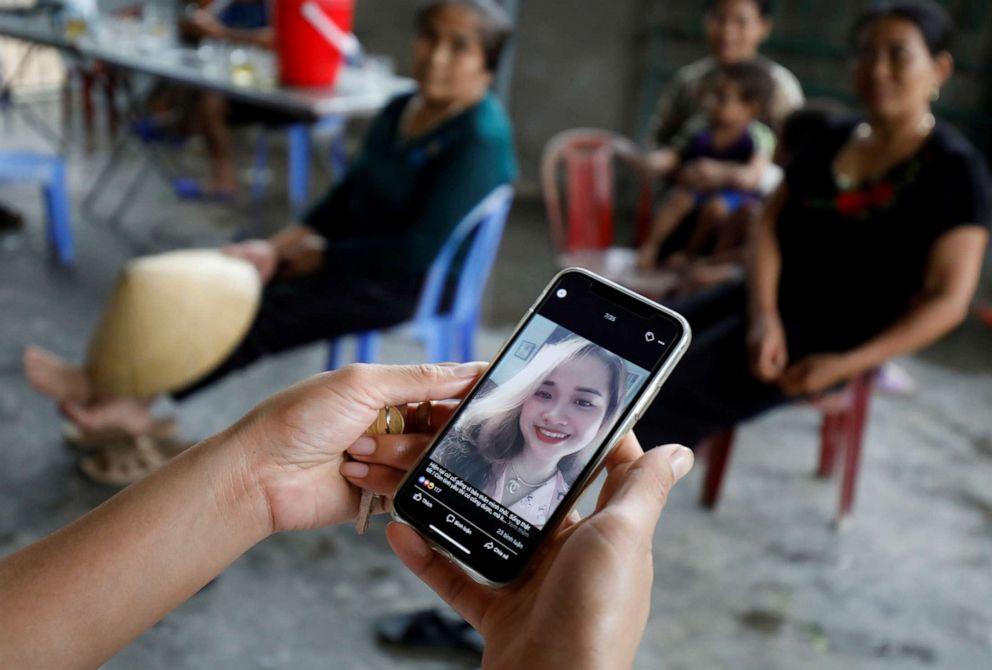 PHOTO: A relative looks at an image of Bui Thi Nhung, 19, who was among the victims found in a lorry in Britain, at her home in Nghe An province, Vietnam, Oct. 26, 2019.