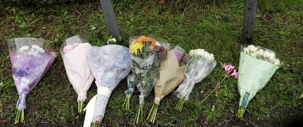 PHOTO: Flowers are seen at the scene where bodies were discovered in a lorry container, in Grays, Essex, Britain, Oct. 24, 2019.