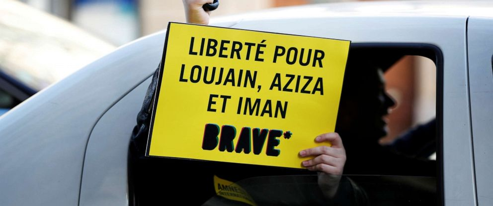 PHOTO: A demonstrator holds a placard outside the Saudi Arabian Embassy to protest on International Womens Day to urge Saudi authorities to release jailed womens activists Loujain al-Hathloul, Eman al-Nafjan and Aziza al-Yousef in Paris, March 8, 2019.