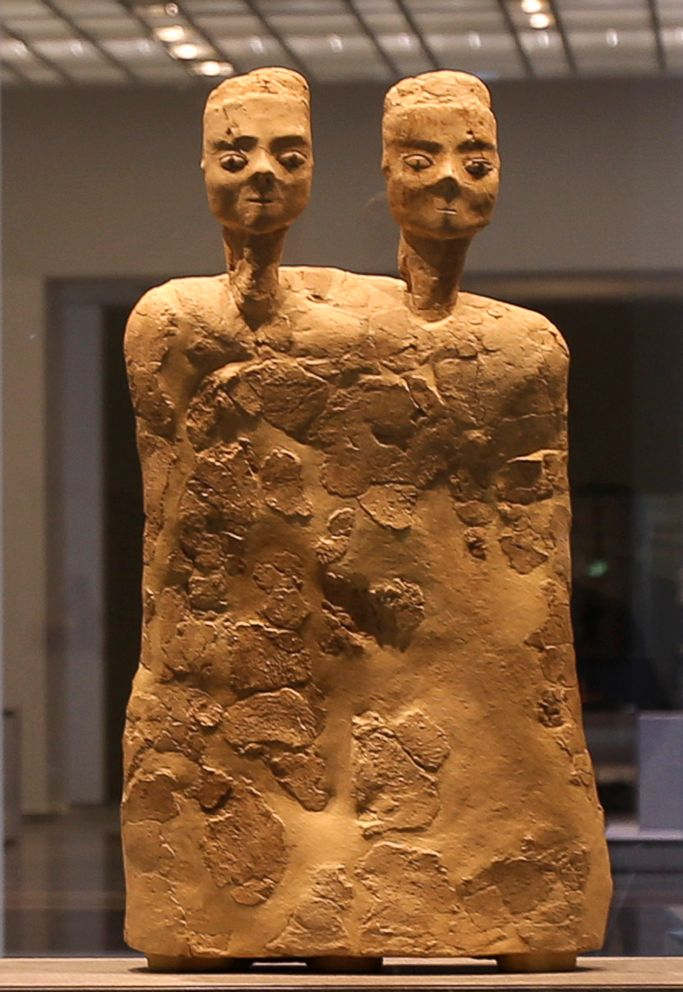 PHOTO: Monumental Statue with two heads from Jordan about 6500 BCE, is displayed at the new Louvre Museum in Abu Dhabi.