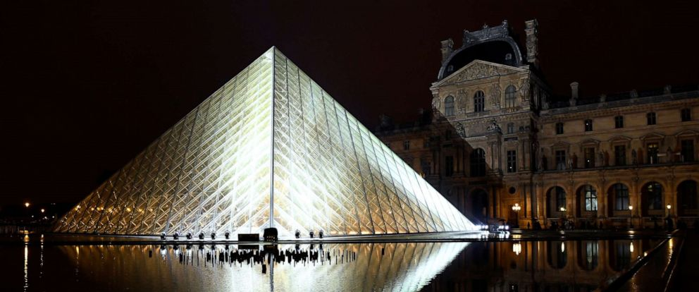 The Louvre Pyramid is illuminated in the night, prior to the Louis Vuitton Spring-Summer 2019 Ready-to-Wear collection fashion show in Paris, Oct. 2, 2018.