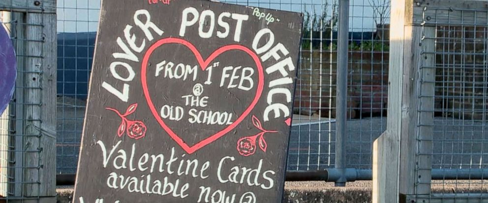 "PHOTO: A pop-up post office in the English village Lover allows visitors to get their Valentines Day cards stamped with an official Lover ""cachet"" stamp."