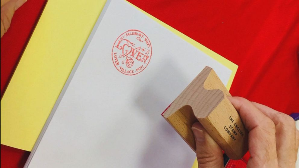 PHOTO: A post office in the English village Lover allows visitors to get their Valentines Day cards stamped with an official Lover cachet stamp.