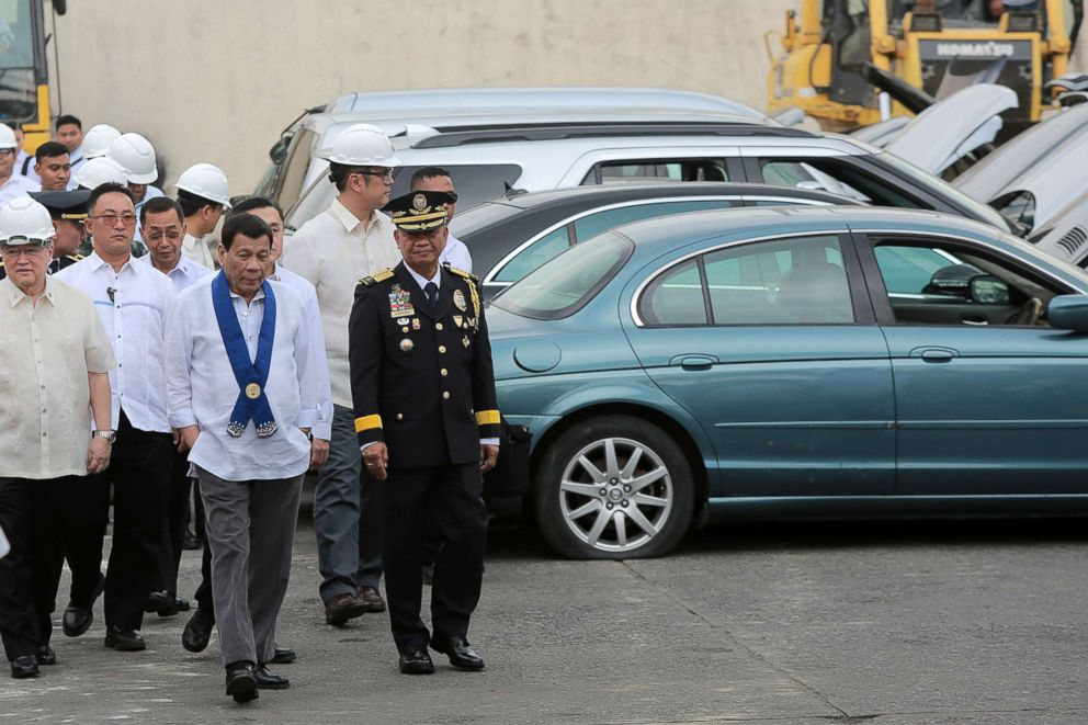 PHOTO: Philippine President Rodrigo Duterte inspects rows of seized luxury cars during the ceremonial destruction at the Bureau of Customs in Manila, Feb. 6, 2018.