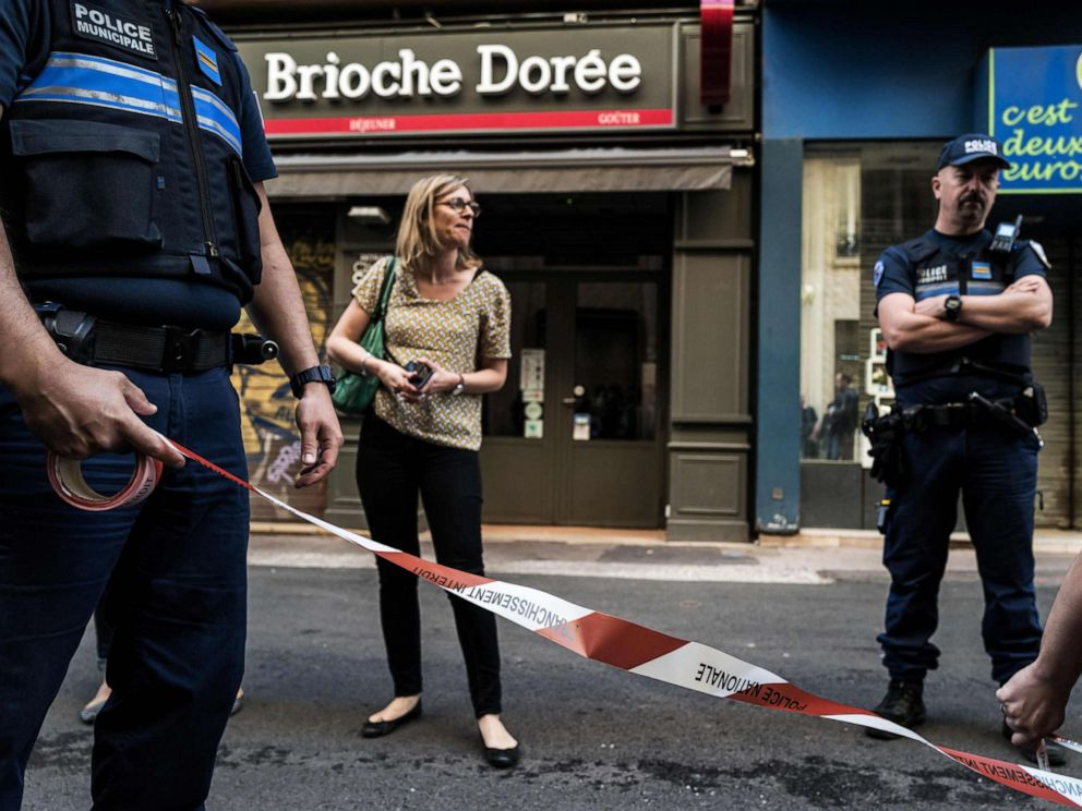 PHOTO: Police officers set a perimeter in front a Brioche doree bakery before French Mayor of Lyons visit, May 25, 2019, the day after a suspected package bomb blast.