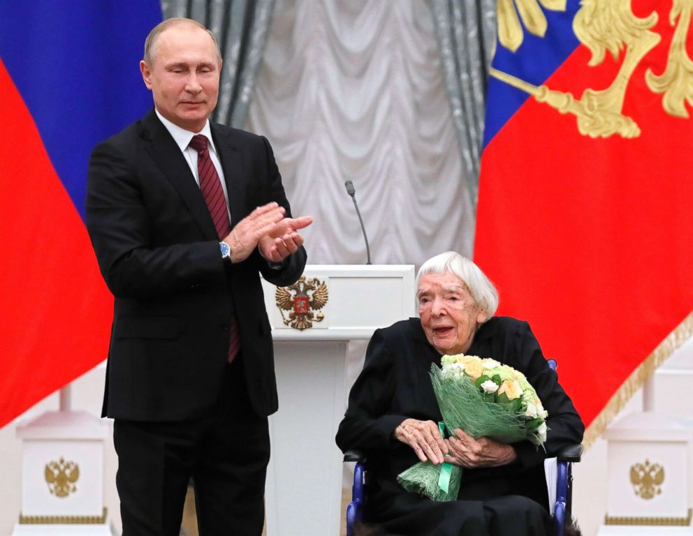 PHOTO: Russian President Vladimir Putin, left, congratulates the Moscow Helsinki Group Chair and human rights activist Lyudmila Alexeyeva, during a ceremony in the Kremlin in Moscow.