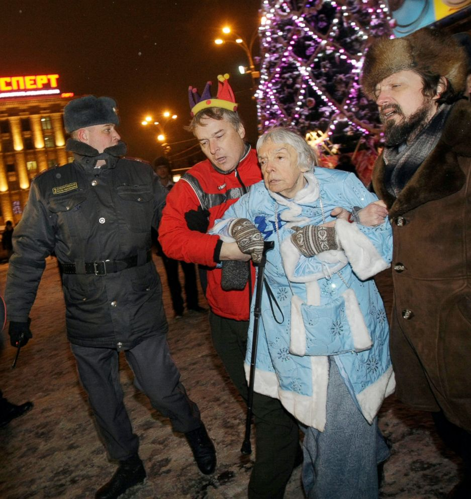 PHOTO: Police officers detain 82-year-old rights activist Lyudmila Alexeyeva dressed as the Snow Maiden during the New Years Eve anti-Kremlin protest in downtown Moscow, Dec. 31, 2009.