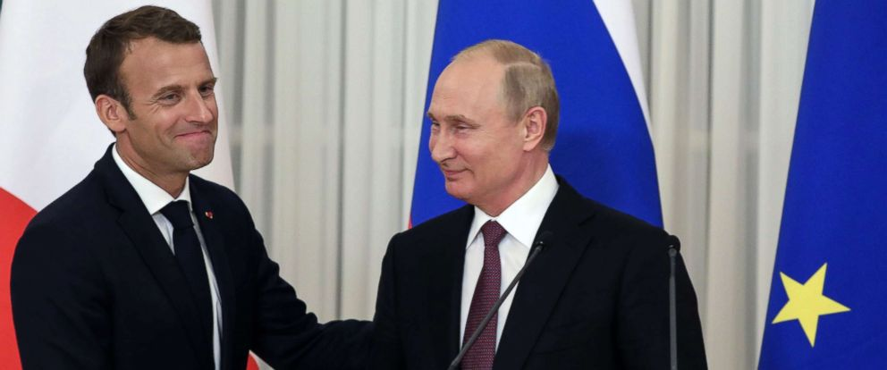PHOTO: Russian President Vladimir Putin shakes hands with French President Emmanuel Macron at the end of a joint press conference in Saint Petersburg, Russia, May 24, 2018.