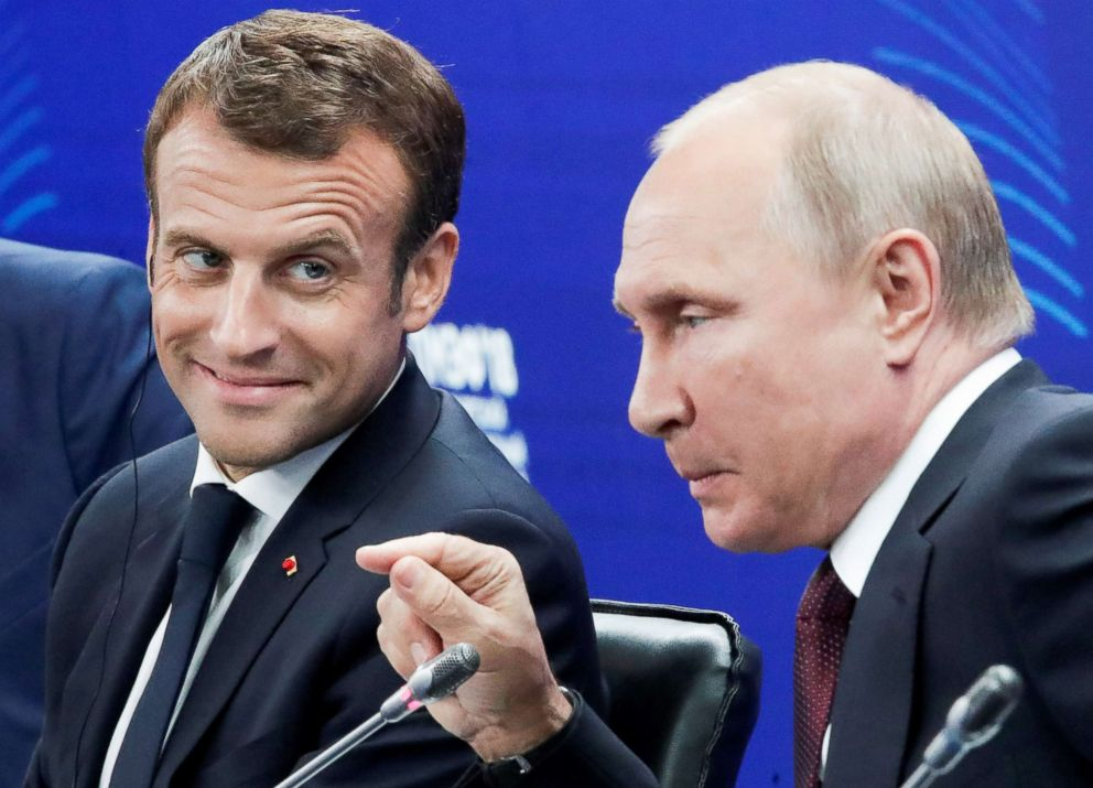 PHOTO: Russian President Vladimir Putin and French President Emmanuel Macron attend a session of the St. Petersburg International Economic Forum (SPIEF) in Russia, May 25, 2018.