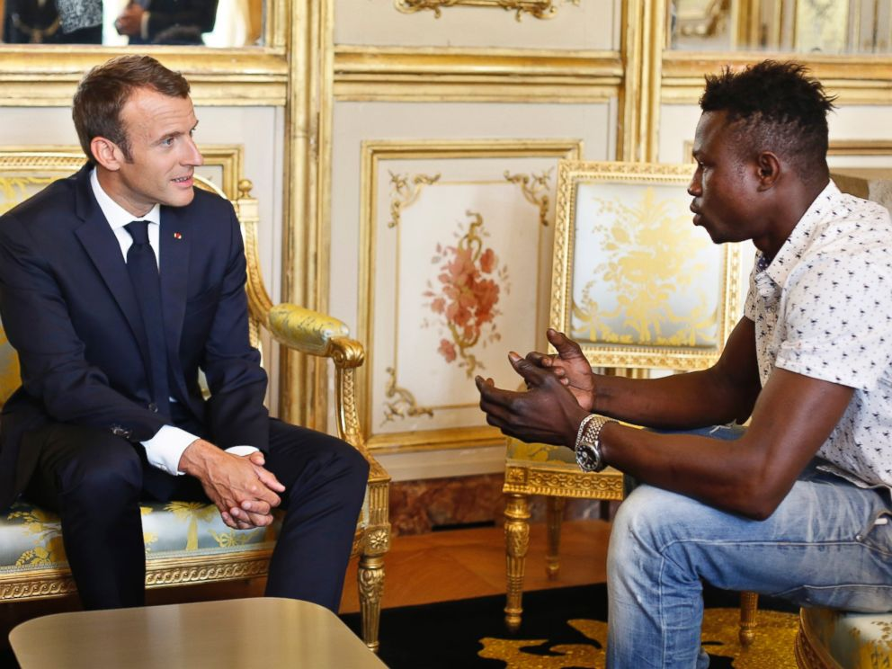 French President Emmanuel Macron, left, meets with Mamoudou Gassama, 22, from Mali, at the presidential Elysee Palace in Paris, Monday, May, 28, 2018.