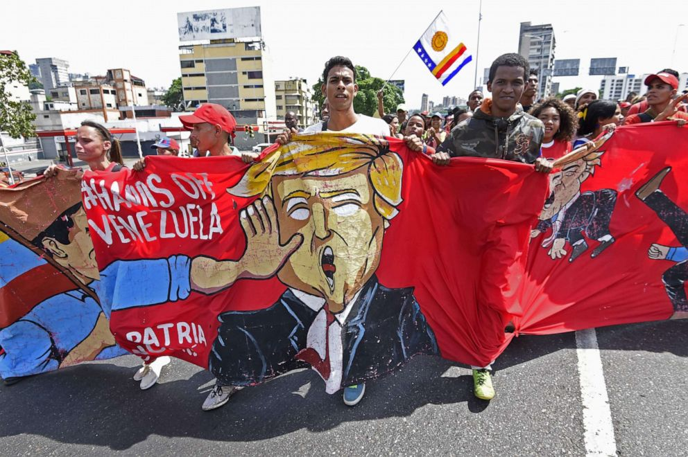 PHOTO: Supporters of Venezuelan President Nicolas Maduro demonstrate against President Donald Trump during a pro-government May Day rally in Caracas on May 1, 2019.
