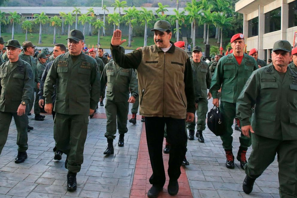 PHOTO: Venezuelas President Nicolas Maduro, center, greets military troops accompanied by Defense Minister Vladimir Padrino, left, at the Fuerte Tiuna in Caracas, Venezuela, May 2, 2019, in a photo released by the Miraflores Palace press office.