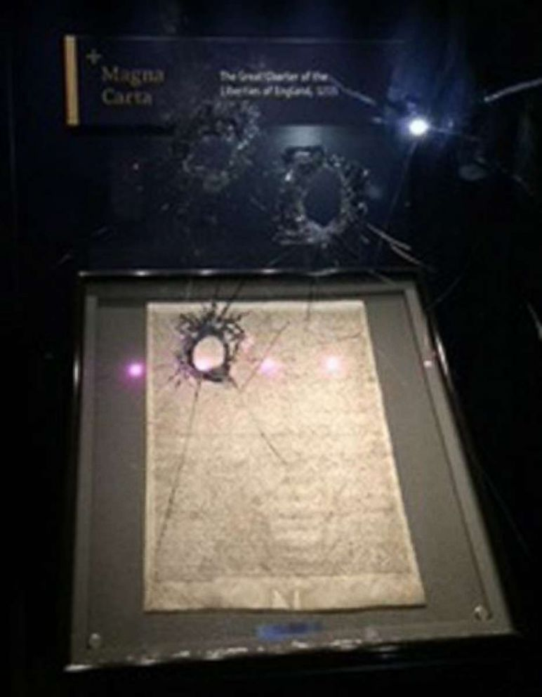 PHOTO: A handout photo made available by The British Wiltshire Police shows damage to the glass box protecting the Magna Carta in Salisbury Cathedral, west England, Oct. 25 2018.