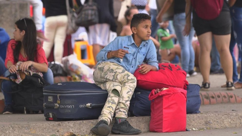 A Venezuelan boy guards bags at the Simon Bolivar International Bridge in Cucuta, Colombia. More than 2 million Venezuelans have fled misery in their country in the past few years.