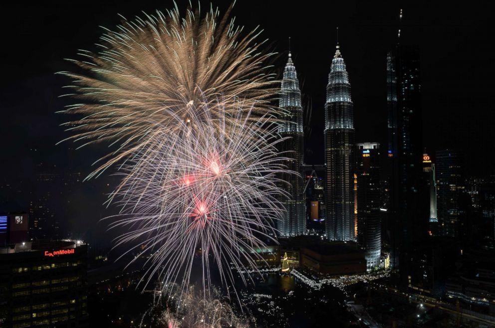 PHOTO: Fireworks illuminate the sky near Malaysias Petronas Twin Towers during New Year celebrations in Kuala Lumpur, Jan. 1, 2018.