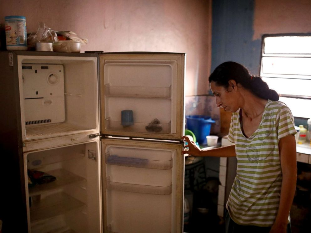 PHOTO: Yaneidi Guzman, 38, shows the food she has in her kitchen at home in Caracas, Venezuela, Feb. 19, 2019.