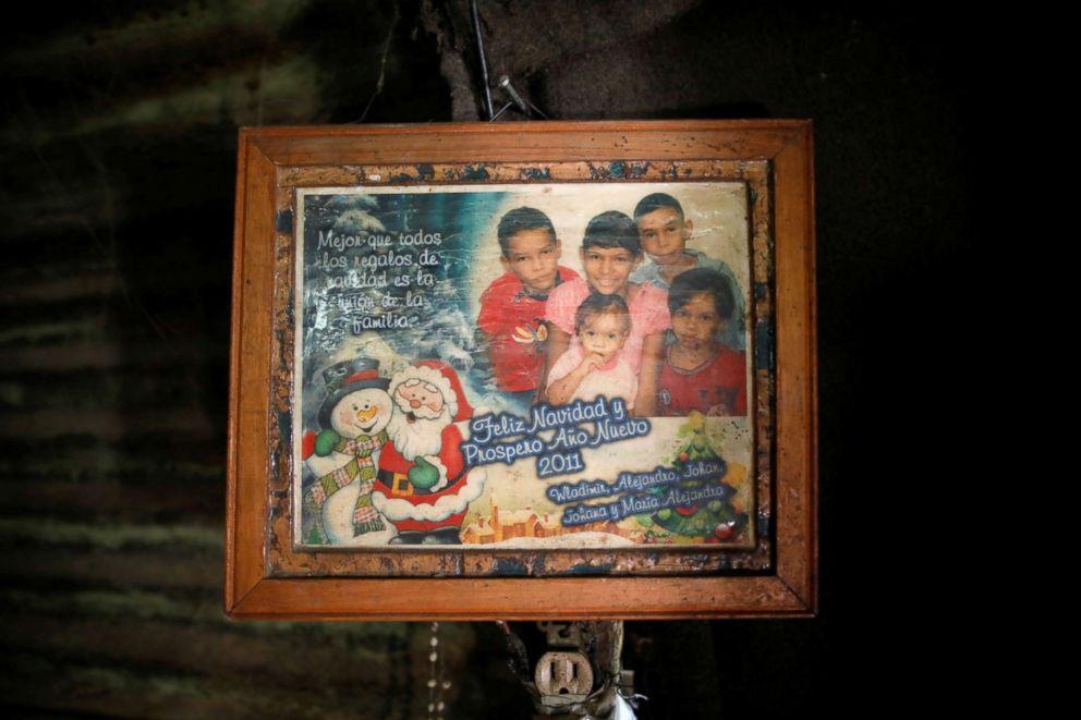 PHOTO: A family photograph hangs in Maria Guitias home near San Francisco de Yare, Venezuela, Feb. 20, 2019.