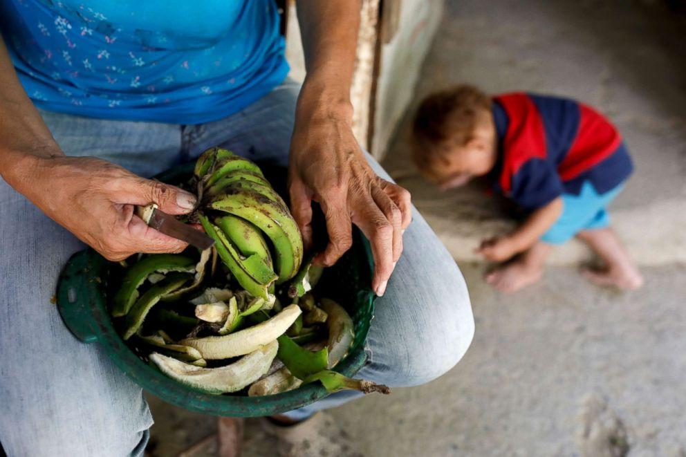 PHOTO: Maira Guitia, the grandmother of Yeibe Medina prepares plantains at home near San Francisco de Yare, Venezuela, Feb. 20, 2019.