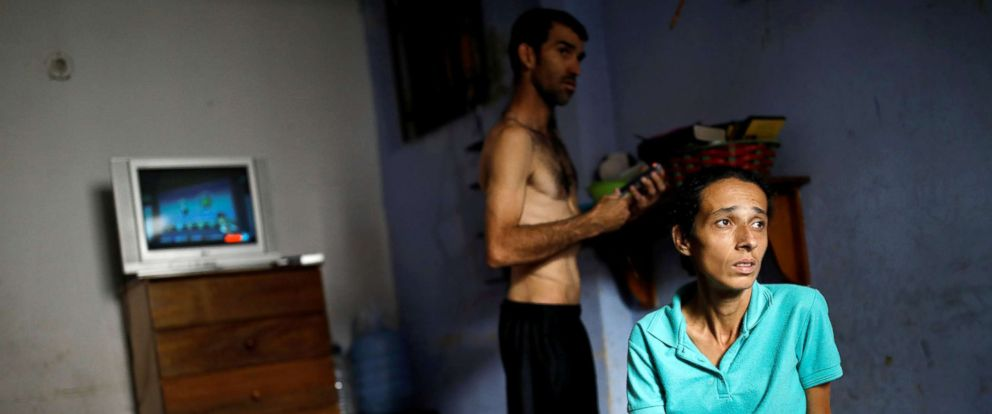 PHOTO: Yaneidi Guzman, 38, sits on her mother-in-laws bed as her husband, Jorge Perez, stands behind her in Caracas, Venezuela, March 31, 2018.